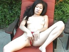 Naked brunette Asian chick rubbing her wet pussy s