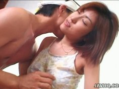 Dude squeezes natural mid sized titties of Miki Kino