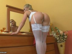 Stunning blonde chick Kathia Nobili poses on a cam wearing sexy white lingerie
