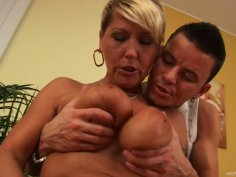 Old granny Berna gets her saggy boobs squeezed and then she gives a quality titjob
