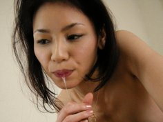 Asian babe in sexy white gets a mouthful of cum