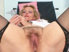 Filthy mature lady toys her hairy pussy with speculum