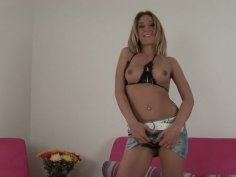 Skanky Cosima is masturbating on a couch using a dildo