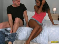 Mulatto beauty gives blowjob and gets her poon drilled on top